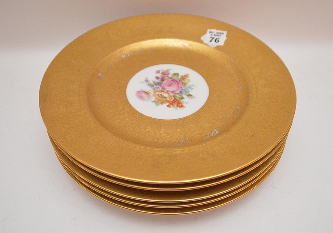 5 dinner plates with floral center and gilded border,