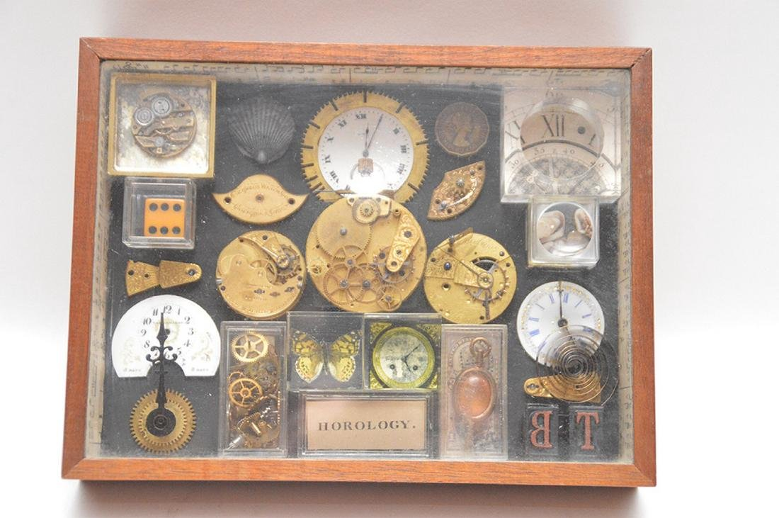 Assemblage of mounted watch parts in shadow box, 8