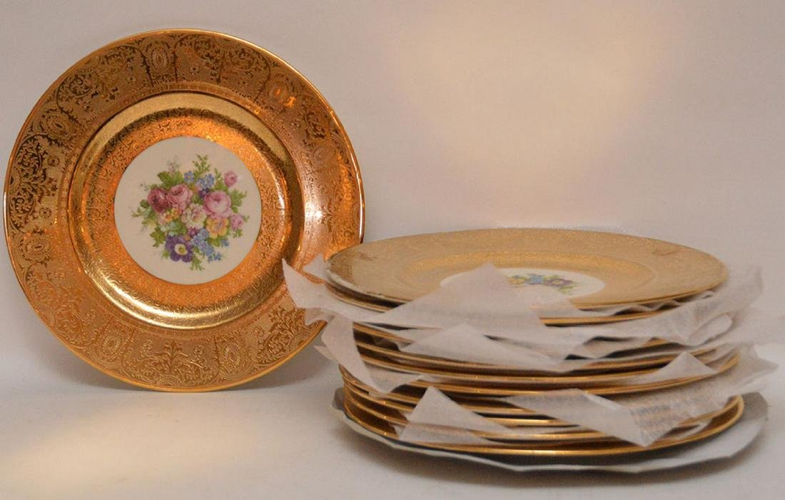 Set 12 Plates with gilt rims.  Condition: some gold is