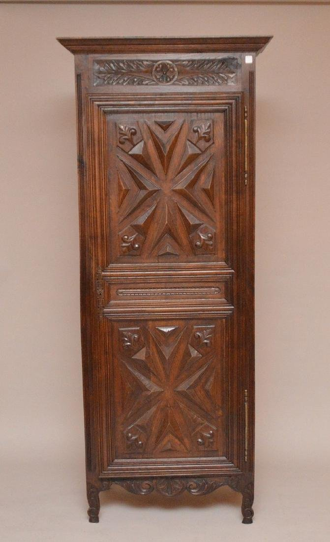 19th c. Continental carved single door cupboard, 75