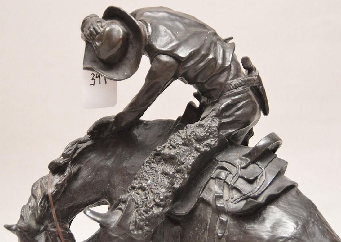 "Remington Bronze restrike of cowboy on horse, 24""h x - 2"