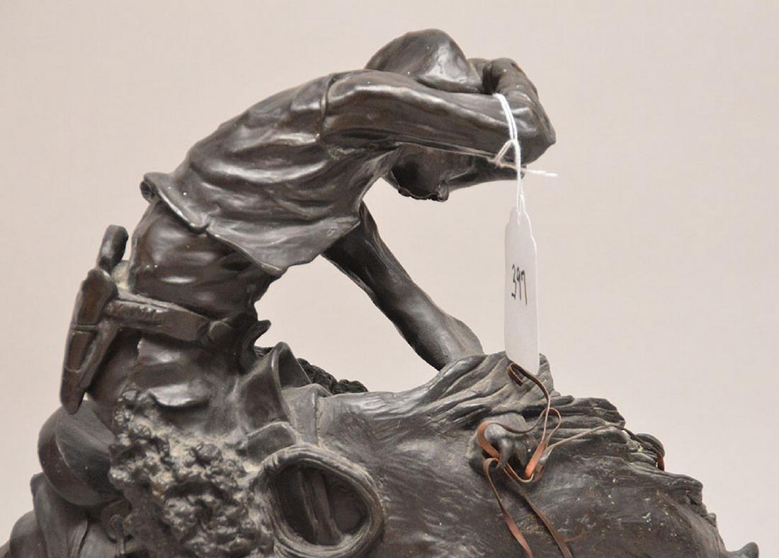 "Remington Bronze restrike of cowboy on horse, 24""h x - 5"