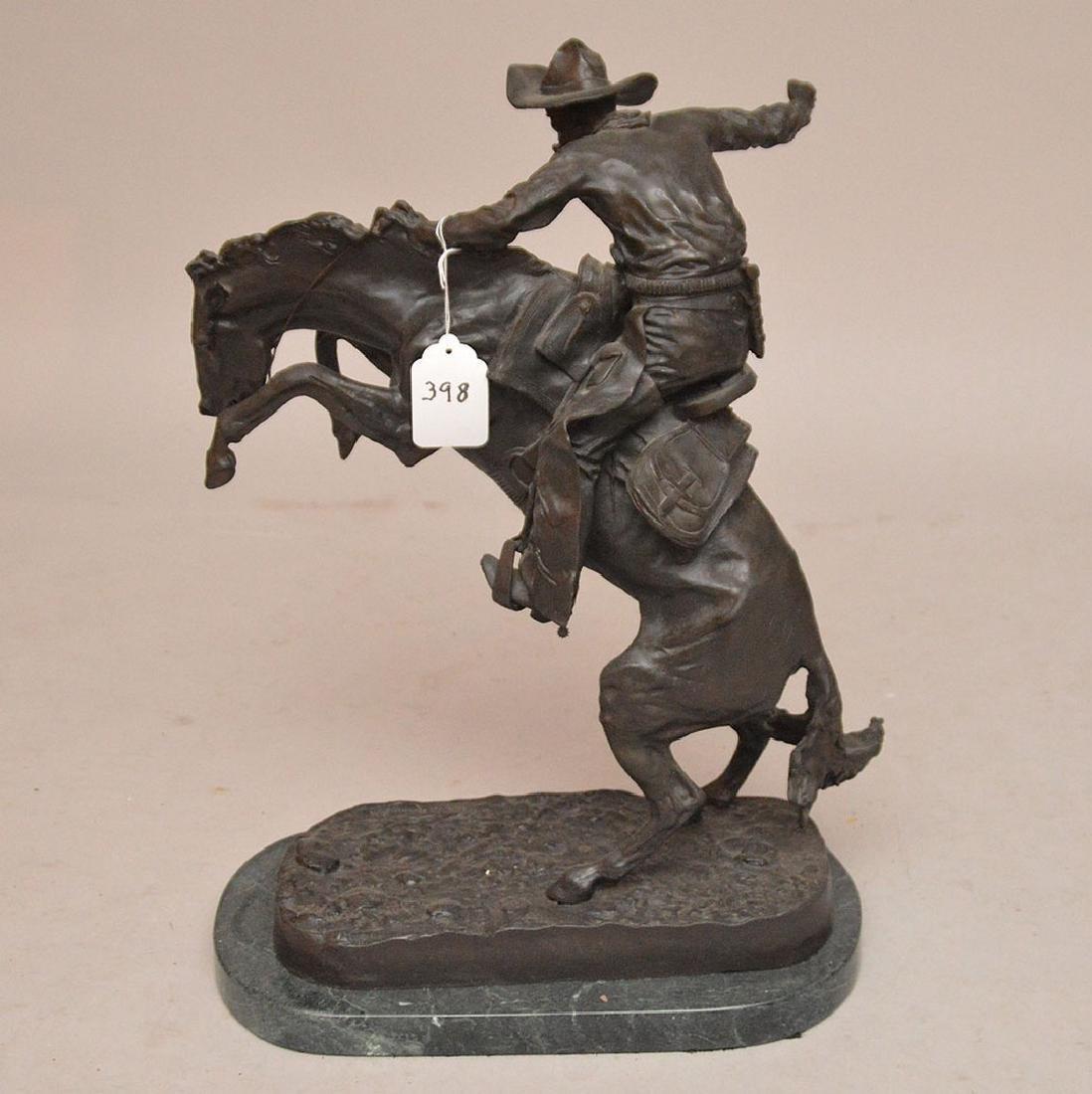 "Remington Bronze restrike of cowboy on horse, 24""h x - 4"