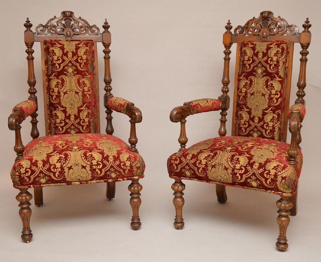 "Pair carved oak arm chairs, 51""h x 24""w"