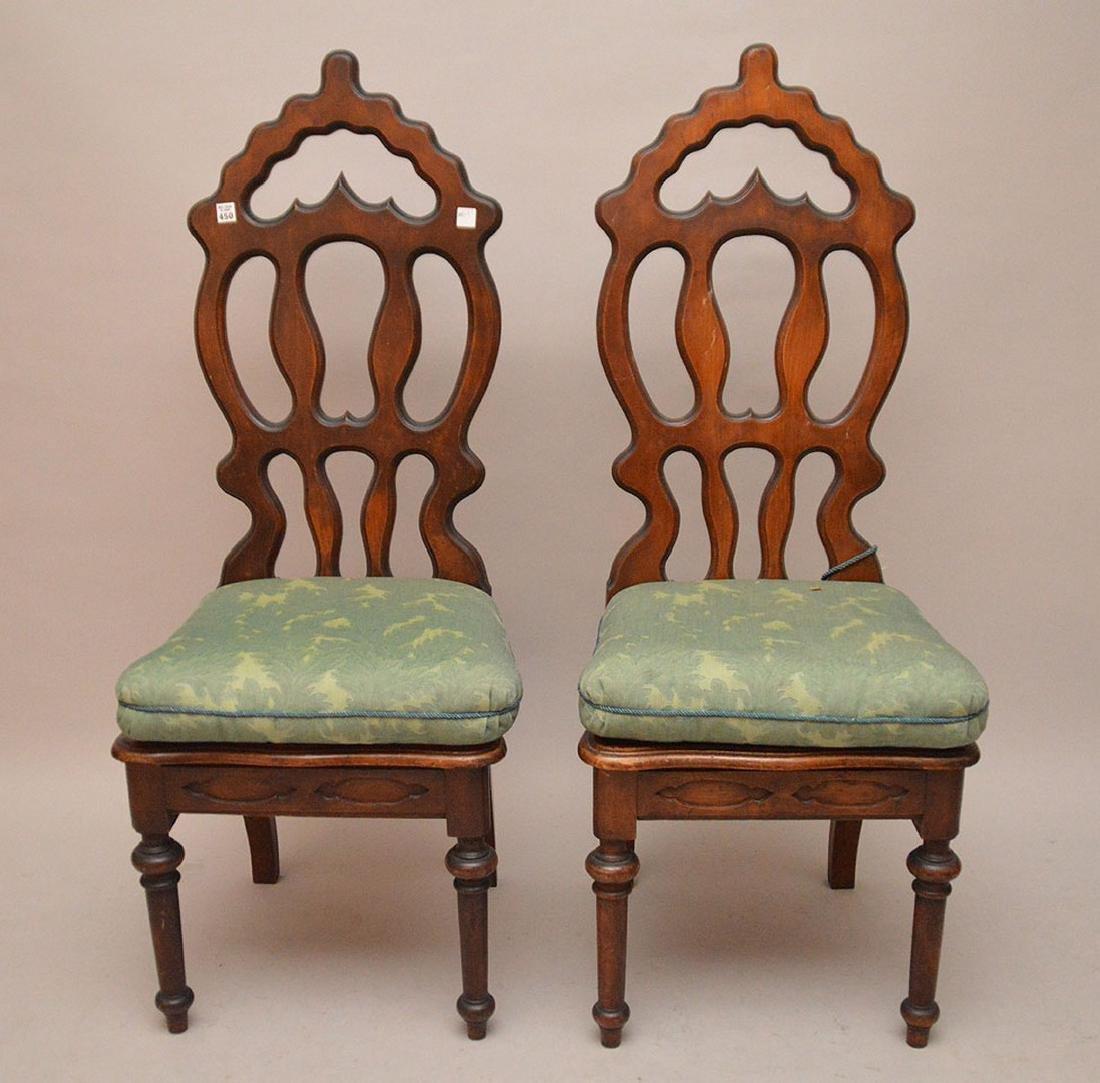 Pair pierced unusual dark wood chairs