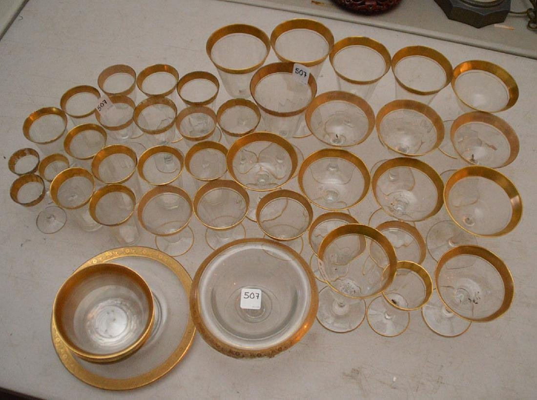 Approximately 40 Pieces Glassware with gold rims.