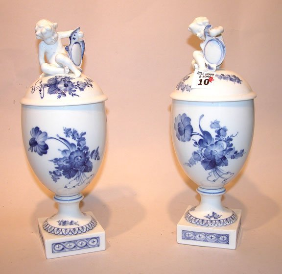 10: Pr. of Royal Copenhagen covered urns w/putti atop,