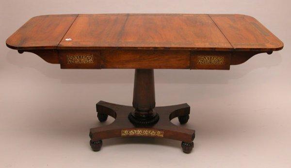 138: Banded, boulle-style, drop leaf table on platform