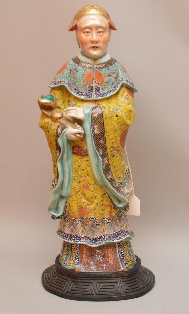 Large Chinese porcelain figure with custom wood base,