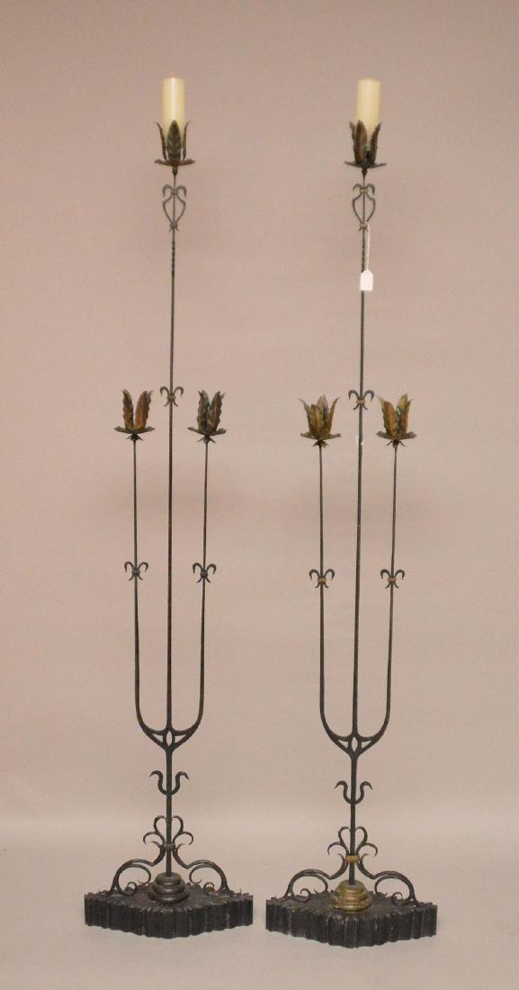 Pair unusual iron 3 branch torcheres