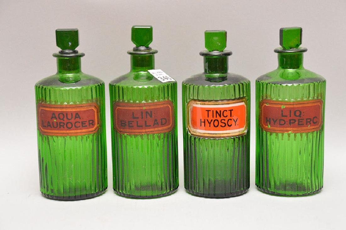 "4 green glass apothecary bottles, 8 1/2""h"
