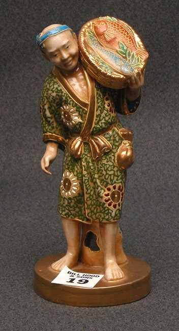 1019: Japanese figurine, man carrying basket of fish, e