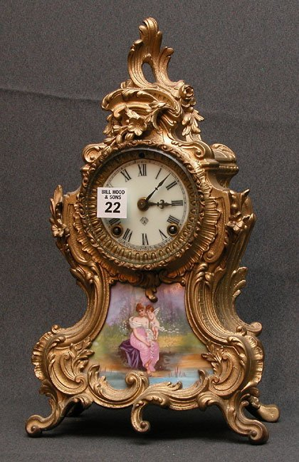 1022: French bronze mantel clock, painting of  mother &