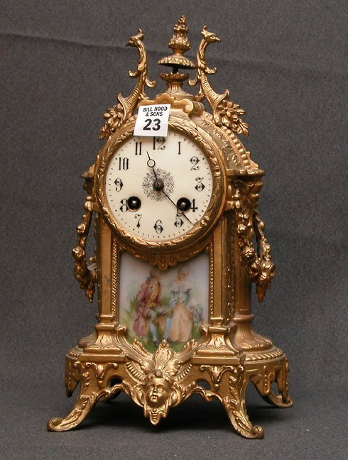 1023: French bronze mantel clock,  with porcelain perio