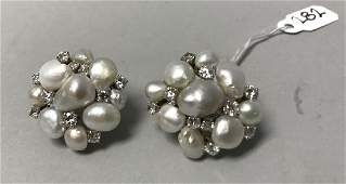 Pair of 14k gold pearl and diamond earrings 100 dwt