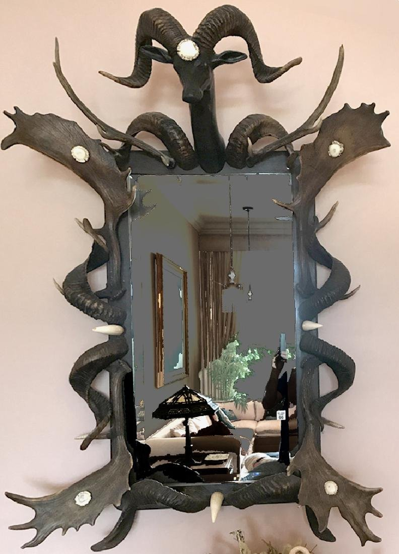 Black Forest Antler Mirror the deer with glass eyes.