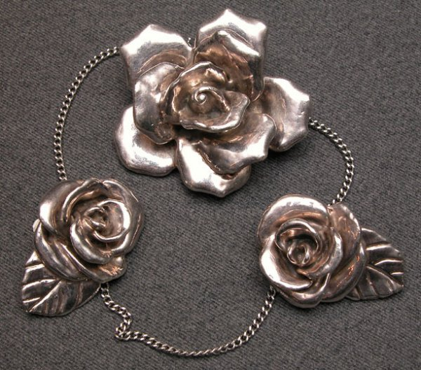 502: Sterling silver 3 inch rose-form pin/pendant, and