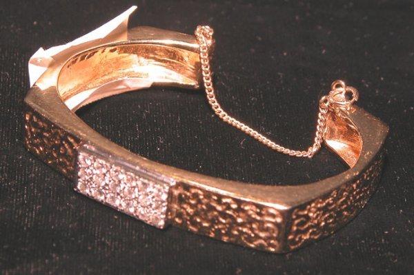 503: Ladies 14 kt.  bangle bracelet with diamonds
