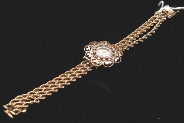 508: Gold ladies watch, triple rope band, round face, 8