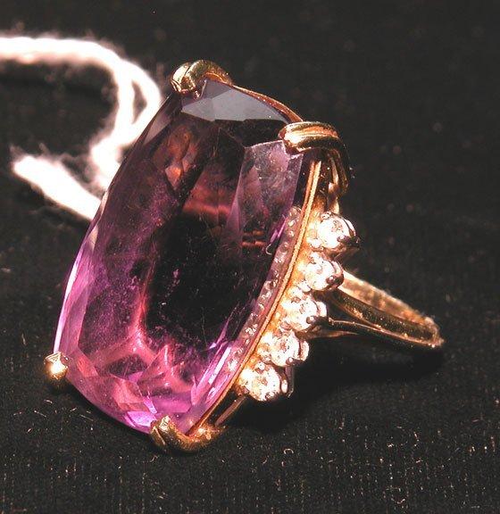509: Amethyst ring, medium color, boat shaped, 27mm x 1