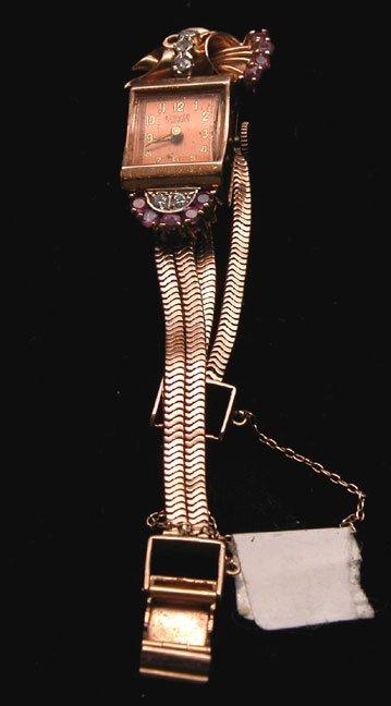 522: Ladies vintage watch, diamond and ruby, 14K, total