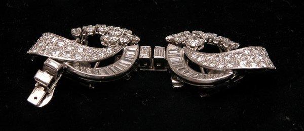 597: Fabulous diamond fur clips set in platinum