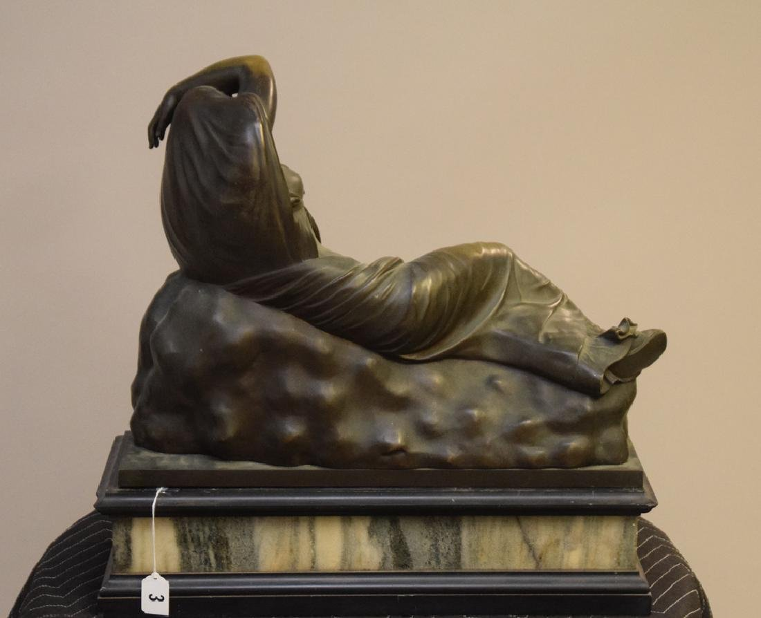 Antique Bronze Reclining Maiden on a marble base. Ht.