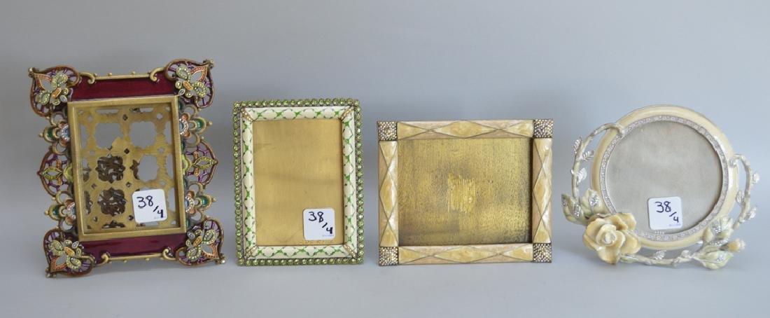 4 Jay Strongwater enamel frames, each signed, frame