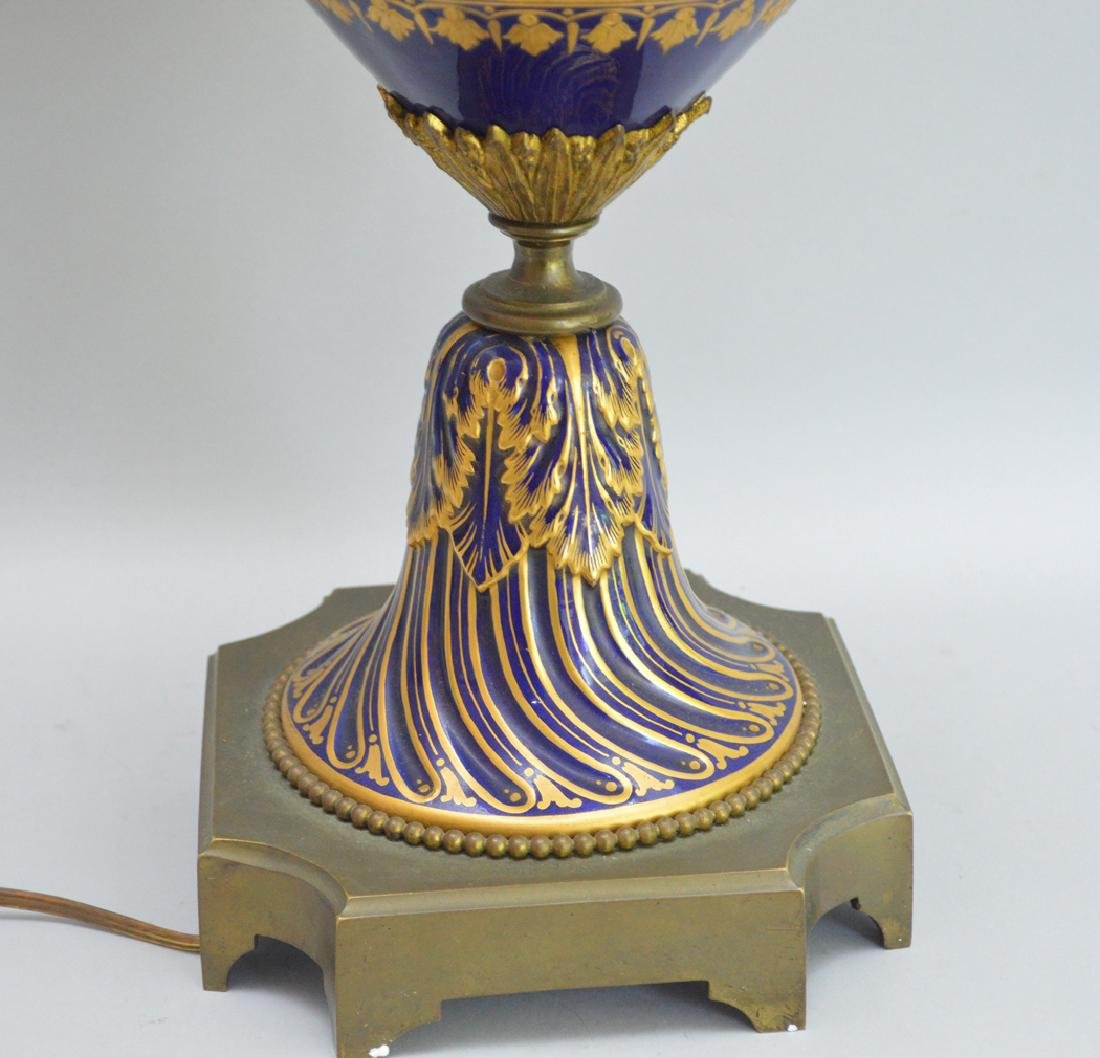 Sevres Porcelain hand painted urn form lamp.  Ht. 37 to - 8