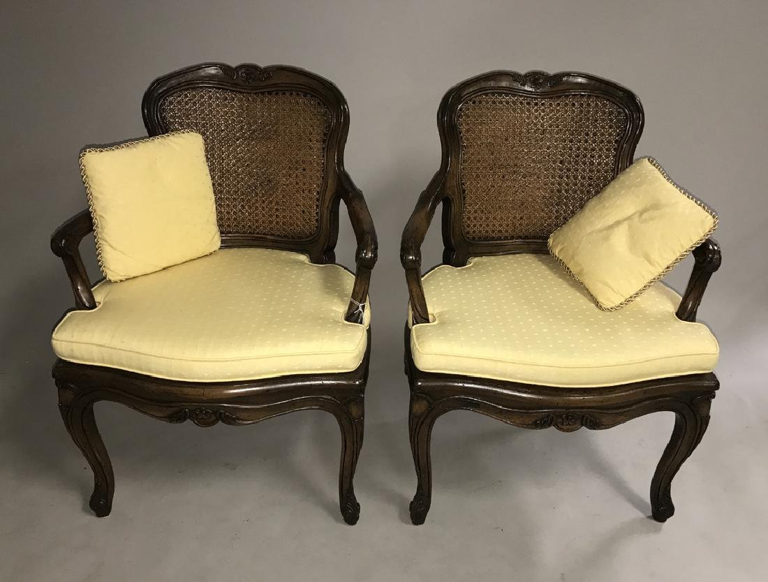 Pair walnut frame French caned arm chairs
