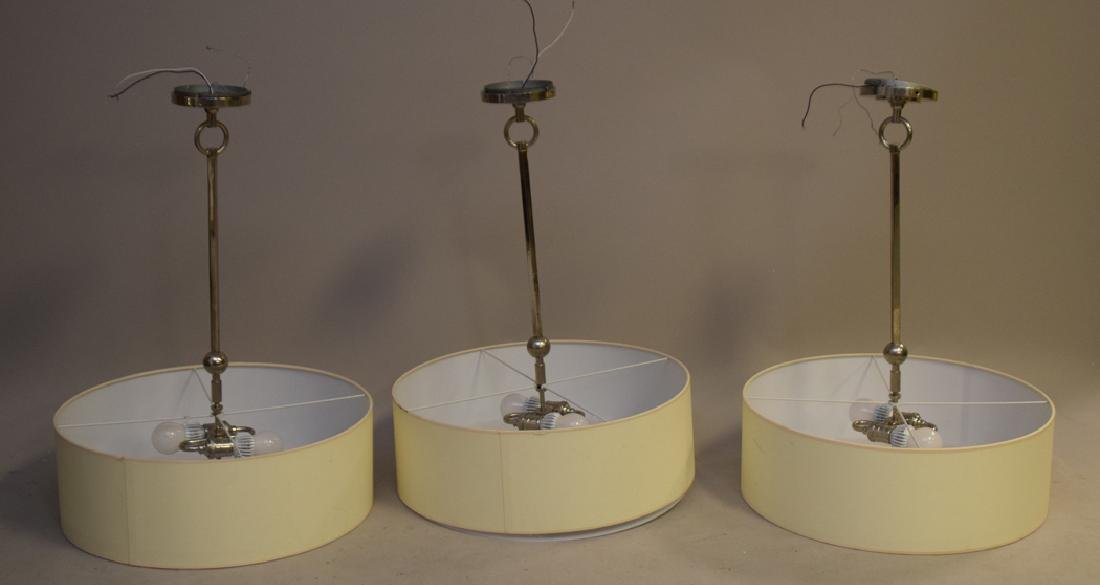 3 modern chandeliers, hanging disc form, parchment