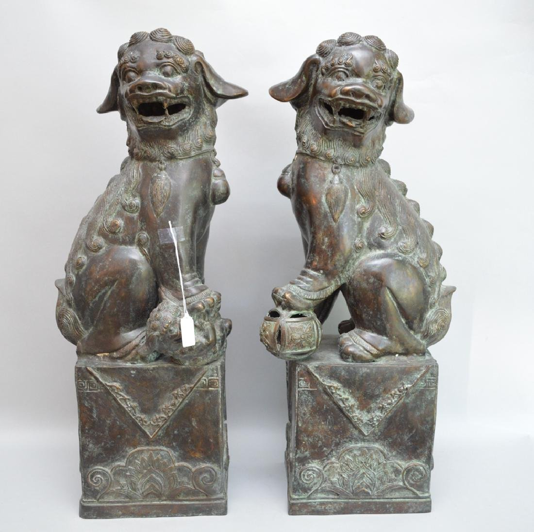 Pair Large Patinated Bronze Foo Dogs.  Condition: good.