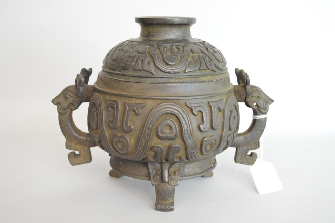Chinese Bronze Urn & Cover with figural handles.  Ht. 7