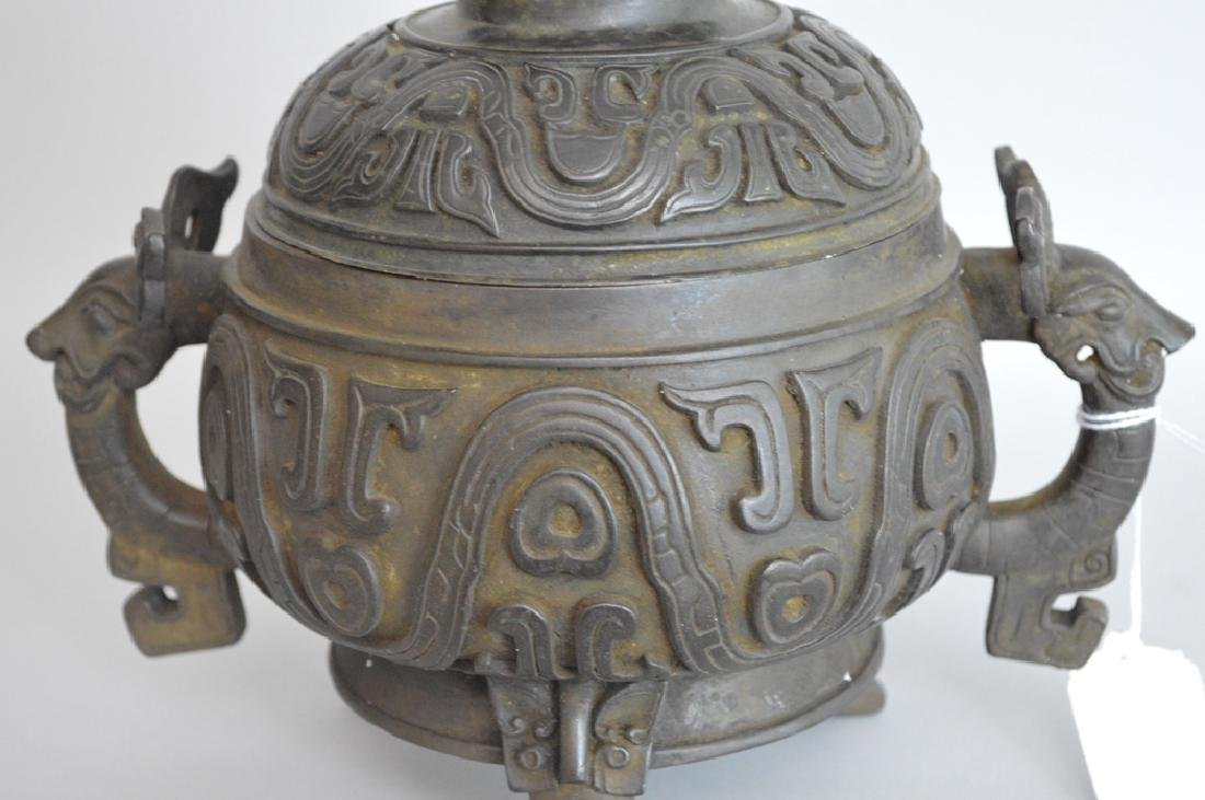 Chinese Bronze Urn & Cover with figural handles.  Ht. 7 - 2