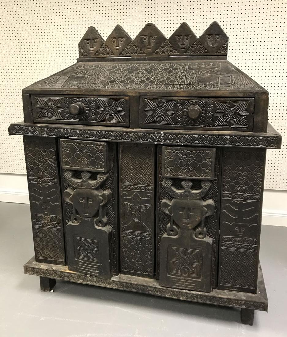 Elaborately carved Island cabinet/chest, 5 faces above