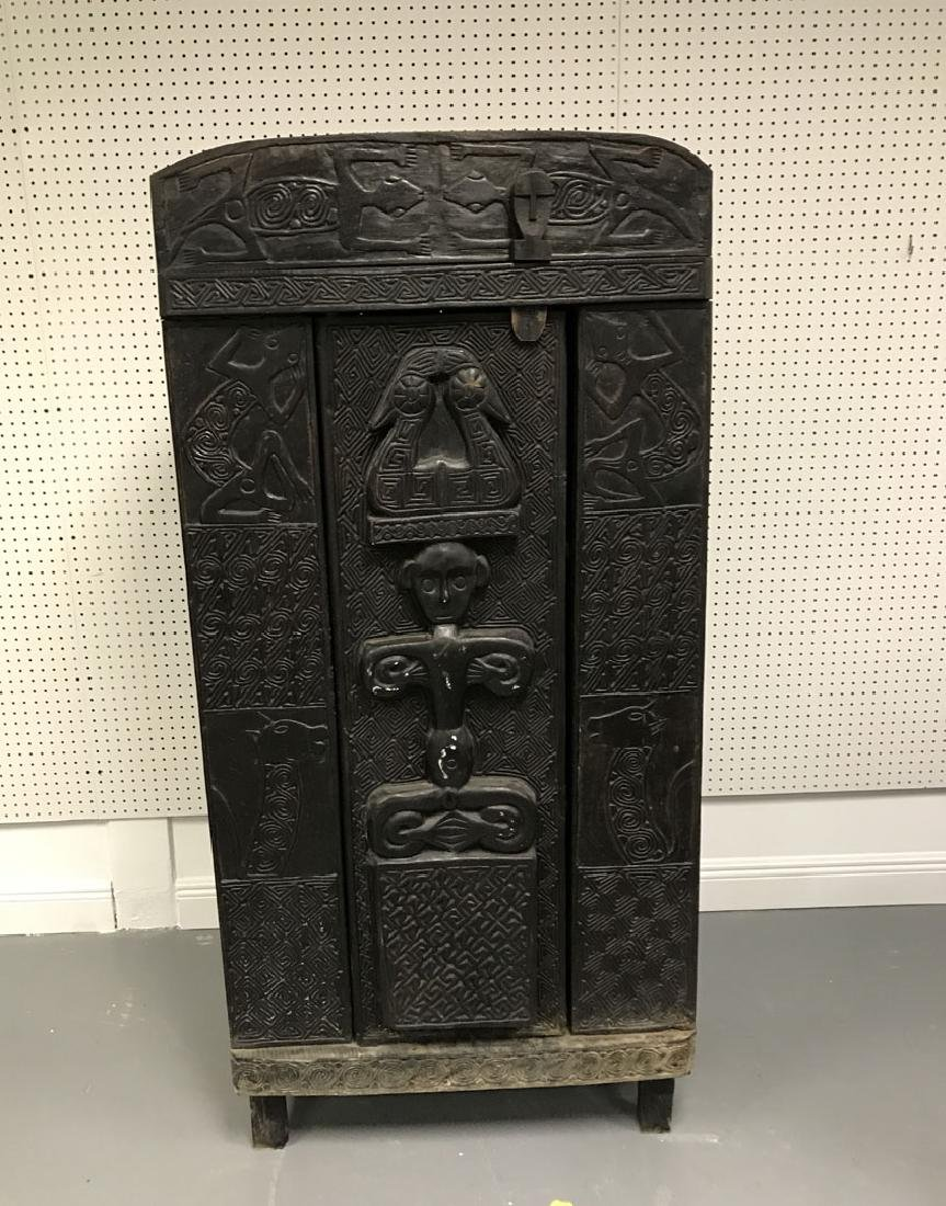 Elaborately carved Island cabinet, 66h x 32w x 16 1/2d