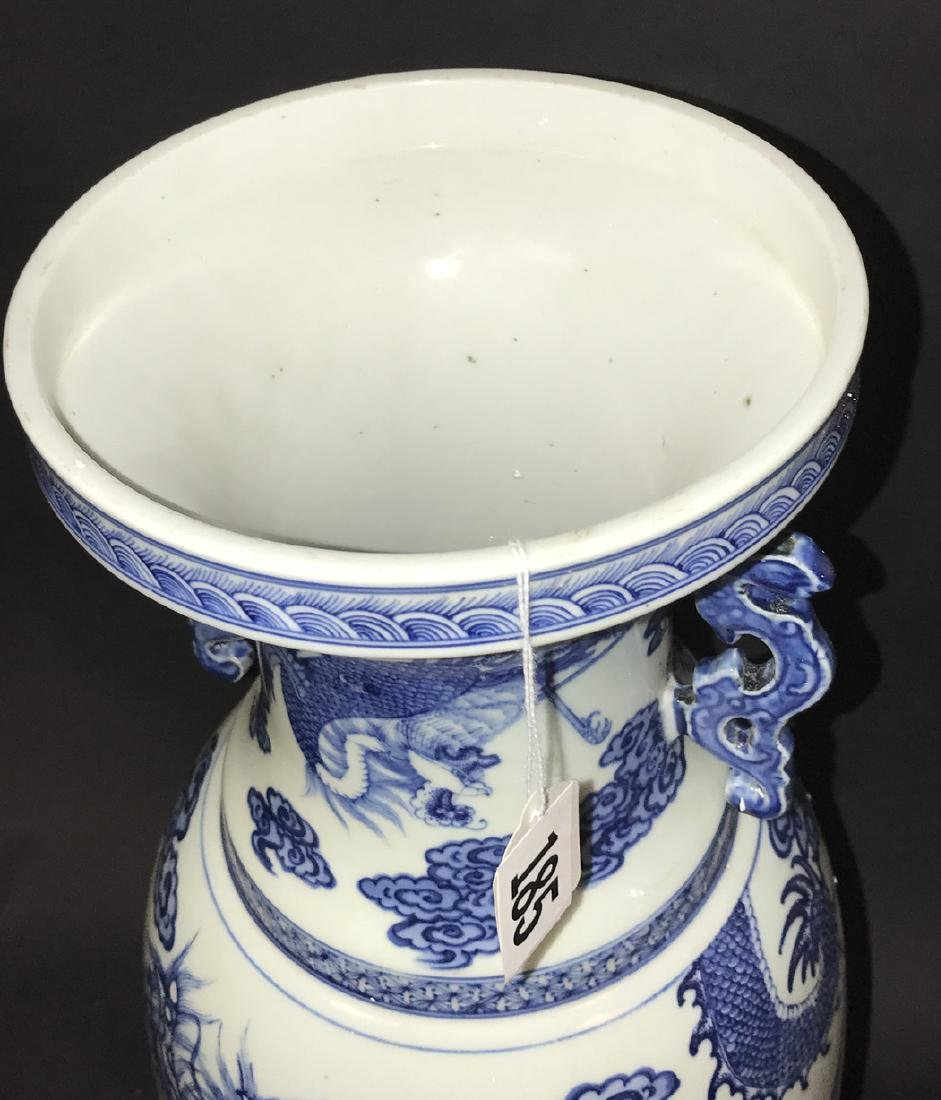 Chinese Porcelain Vase with blue dragon decoration on a - 2
