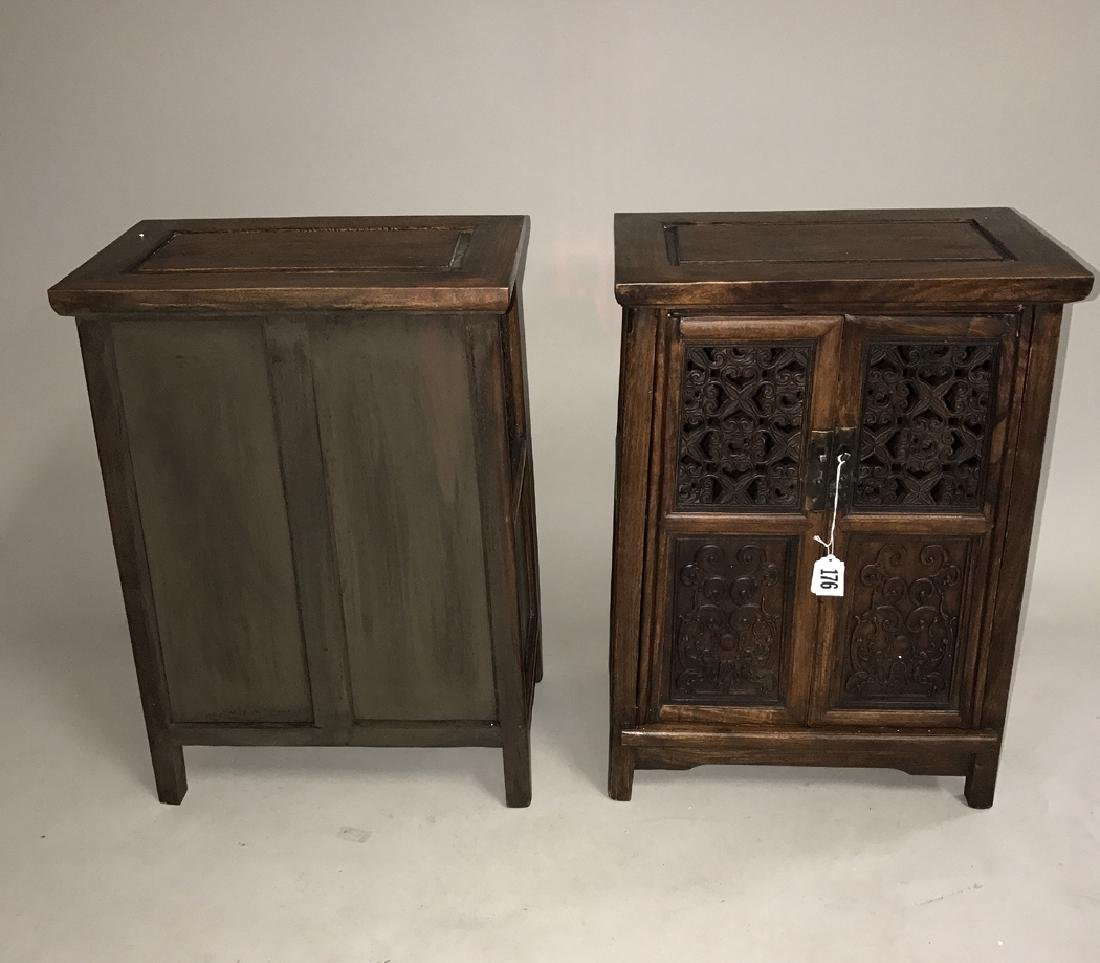 Pair Chinese cabinets each with 2 carved panel doors,
