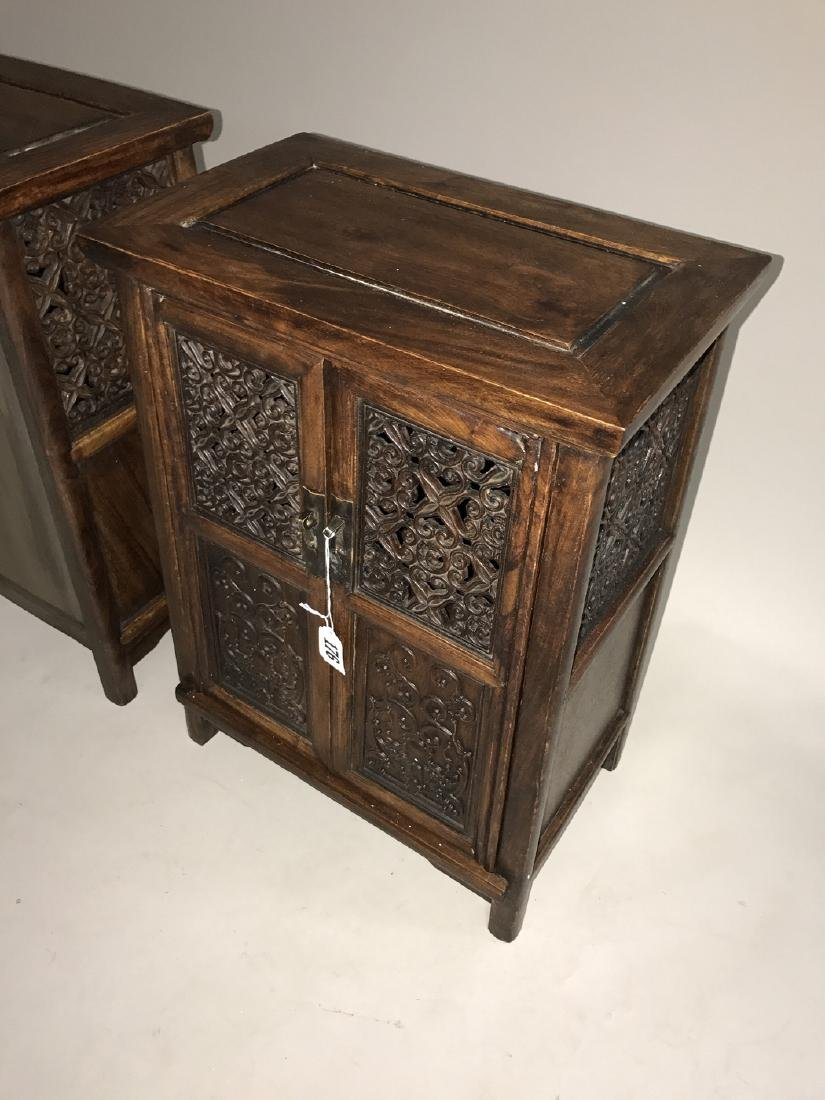 Pair Chinese cabinets each with 2 carved panel doors, - 2