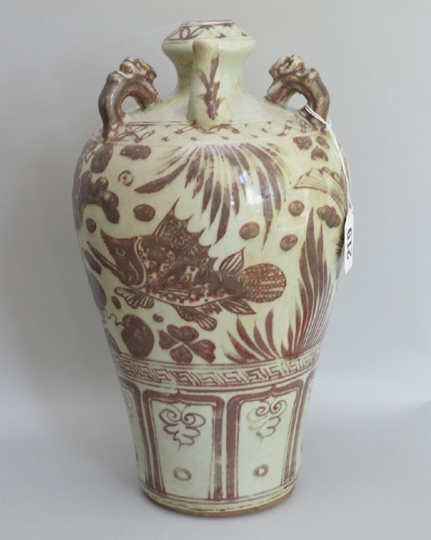 Chinese Porcelain Jug with rouge decoration on a white
