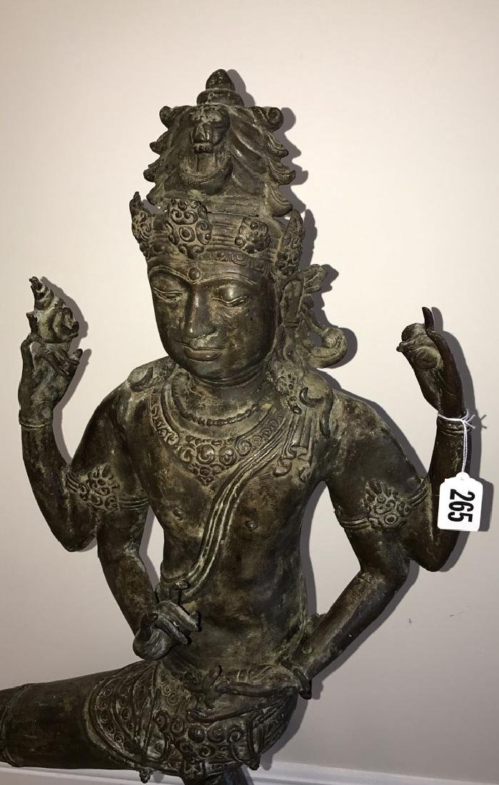 Bronze buddha with 4 arms, standing on small figural