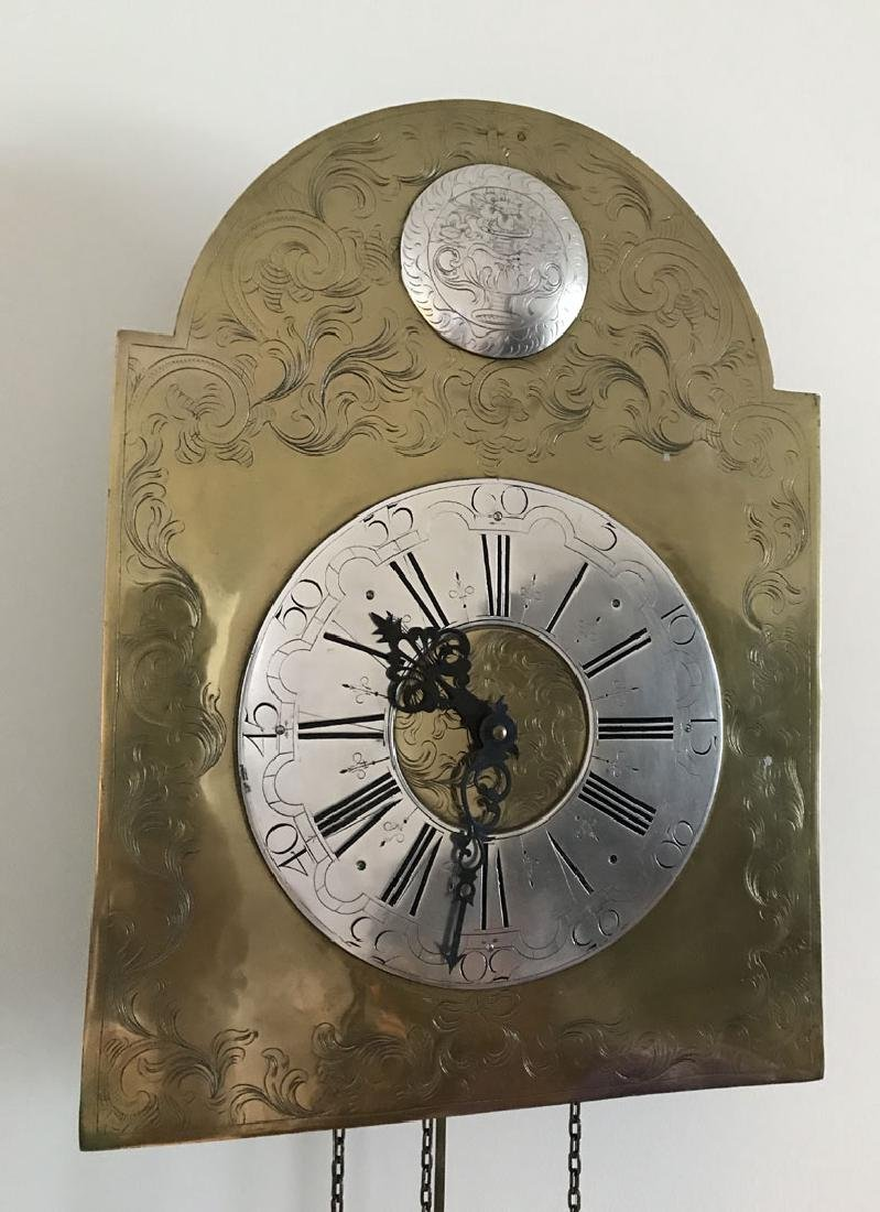Hanging brass and nickel wall clock