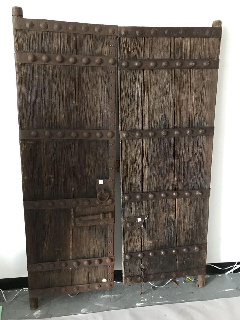 Pair primitive doors with original iron hardware, 76h x