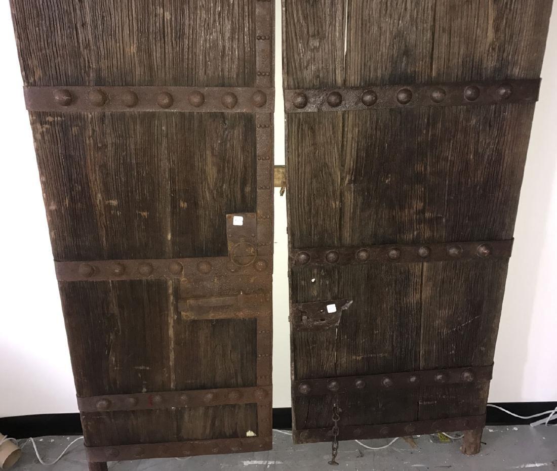 Pair primitive doors with original iron hardware, 76h x - 4