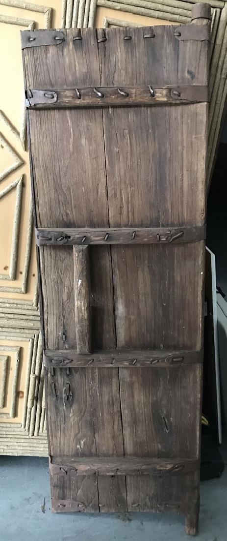 Pair primitive doors with original iron hardware, 76h x - 7