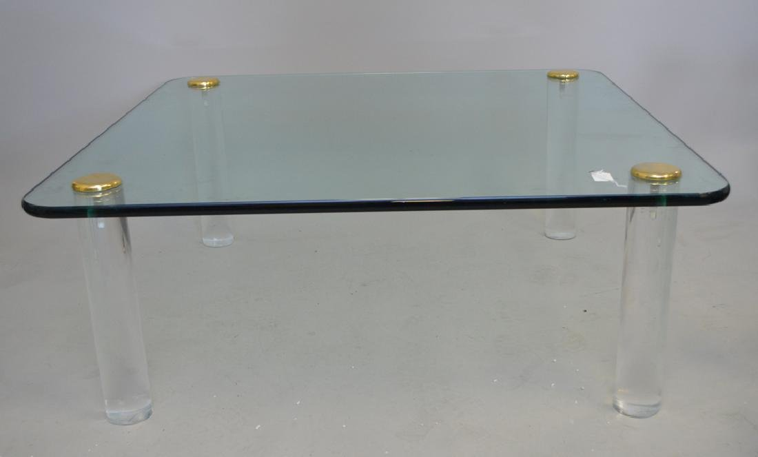 Glass coffee table with Lucite legs