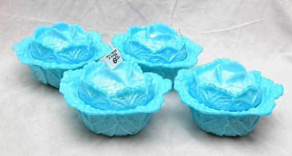 1006: 4 blue glass covered bowls