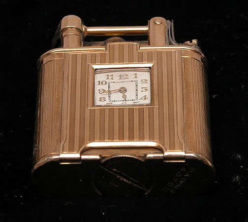 """209: Dunhill clock lighter 9 kt Gold """"Pat. No.143752"""""""