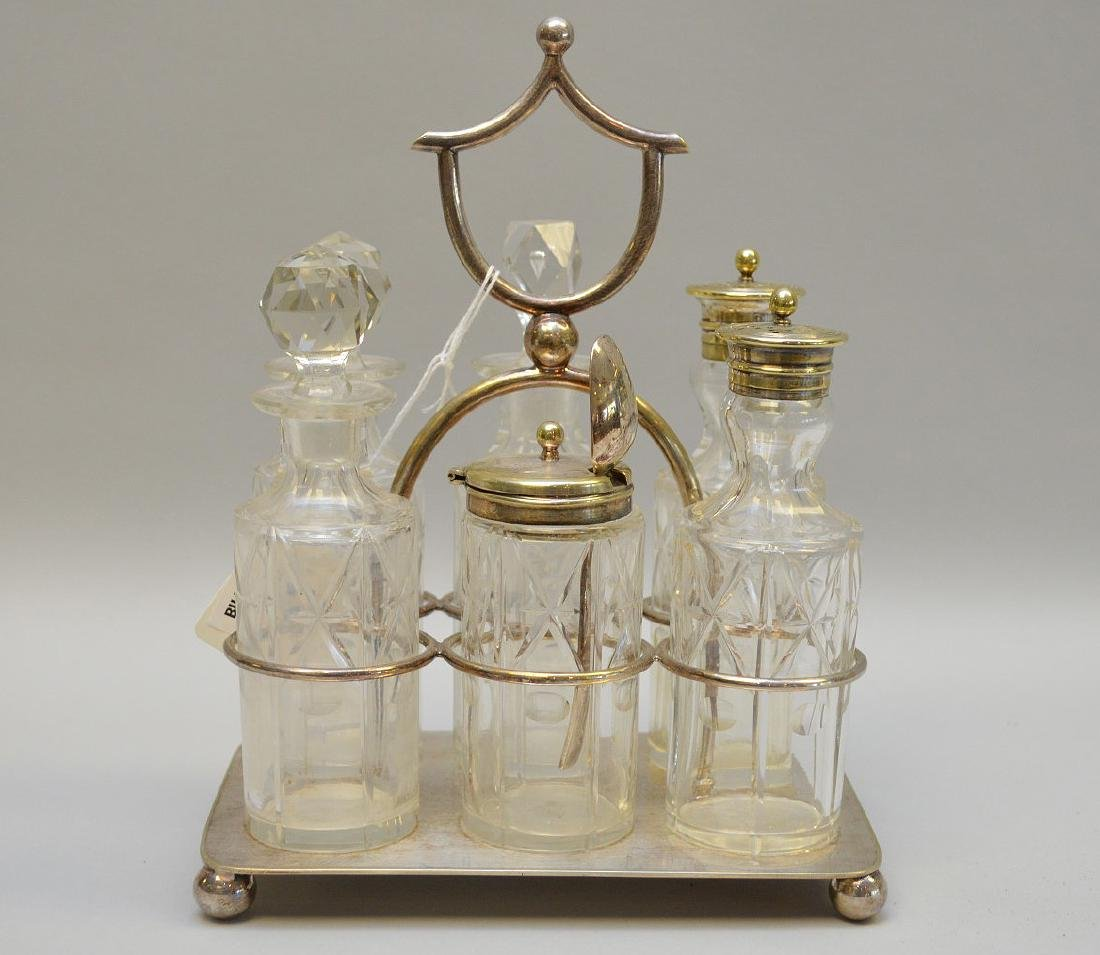 "Cruet set, 6 bottles in silverplate frame, 9""h x 7""w"