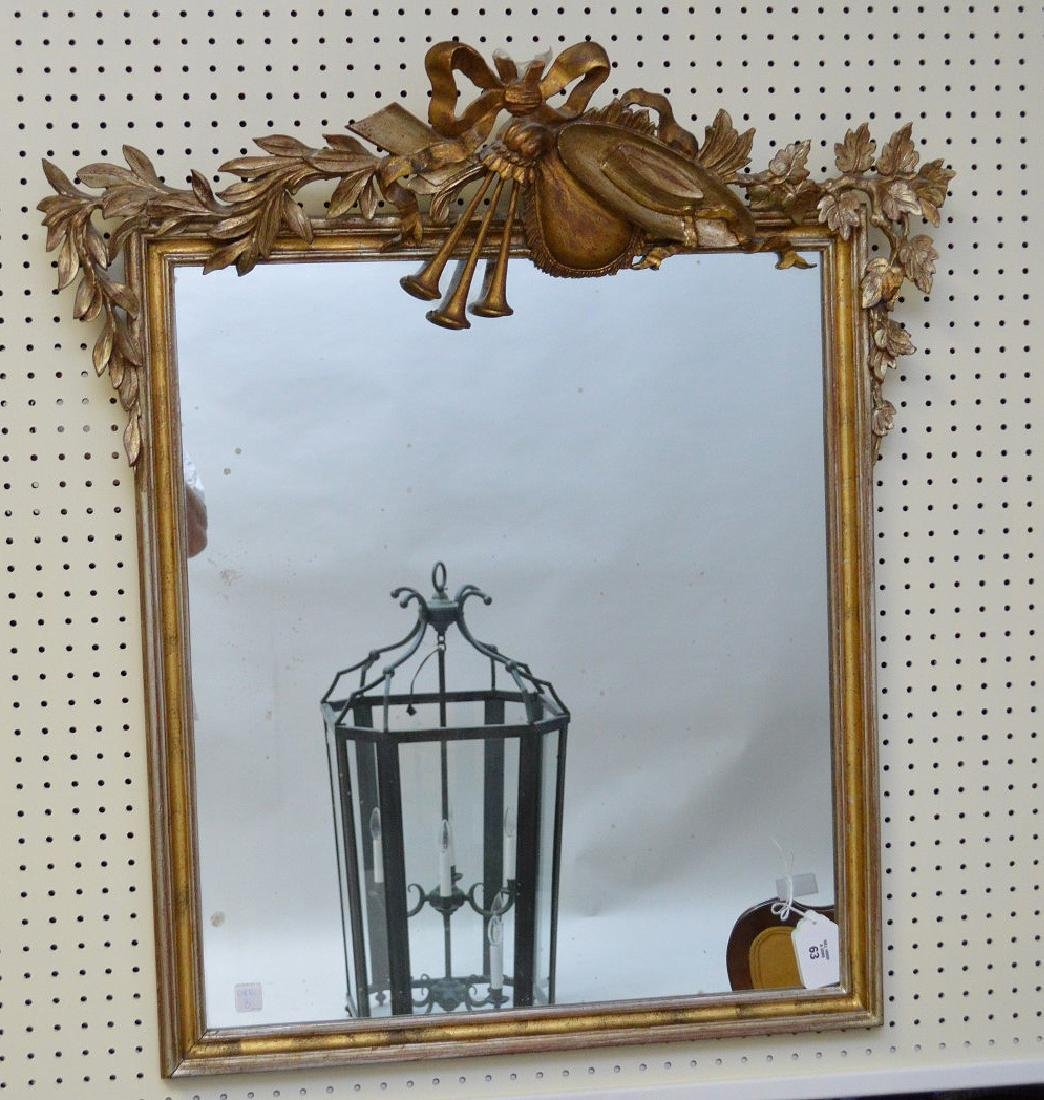 "Trophy and Laurel leaf gilded framed mirror, 36""h x"
